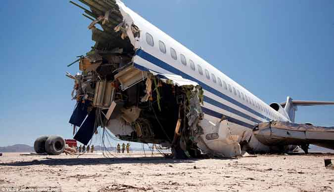 fuselage ripped in two crash landing Boeing 727 Mexican desert devastating impact collision film documentary scientific tests serious survivable crash improve safety Watch a Boeing 727 test crash into the desert