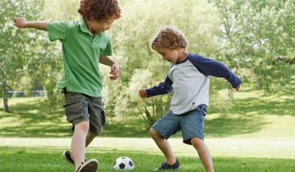 kids playing sunscreen soccer football sun outdoors park The best beach & sports sunscreens