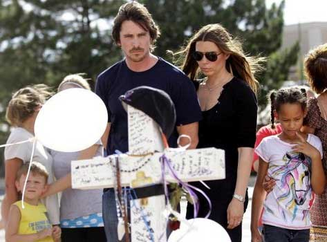 Actor Christian Bale and his wife Sandra Blazic visit the memorial across the street from the Century 16 movie theater July 24 2012 in Aurora Colorado. Credits Joshua LottGetty Images 3 of the 12 victims in the Aurora shooting died protecting their ladies