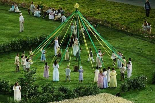 Maypole-dancing-during-the-Opening-Ceremony-pre-show-Children-dance-around-the-maypole-during-the-pre-show-ahead-of-the-Opening-Ceremony.-There-are-four-maypoles-featured-in-the-Green-and-Pleasant-Land-section-of-the-Ceremon.jpg