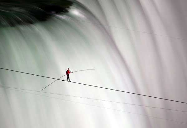Nik Wallenda of the Flying Wallendas acrobatic dynasty walks 1800 feet 550 meters across Niagara Falls by tightrope on June 15—a first. The best pictures of June from National Geographic