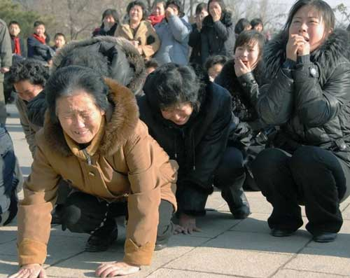 laughing crying north korea communist party leader kim jong il 25 pictures of North Koreans losing it over Kim Jong Ils death