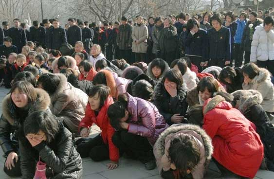 north korean communist party leader death kim jong il crowd weeping on the ground 25 pictures of North Koreans losing it over Kim Jong Ils death