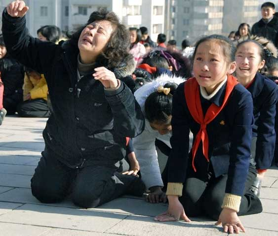 north korean communist party leader death kim jong il mother grandma kids on the floor 25 pictures of North Koreans losing it over Kim Jong Ils death