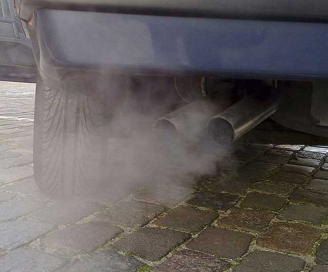 car exhaust pollution tail pipe Close a 10 mile section of highway   air quality immediately improves by 83%