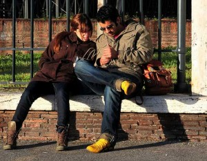 sitting couple reading cell phone stylish fashionable man woman yellow shoes boots jacket glasses 300x233 sitting couple reading cell phone stylish fashionable man woman yellow shoes boots jacket glasses